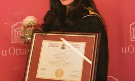 Caregiver's daughter graduates 'Magna Cum Laude'
