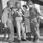 Mr. & Mrs. Hal Bowie and baby daughter Lea. Los Banos Interment Camp survivors, Laguna, Philippines 1945
