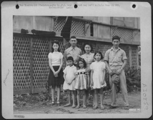 Joe Price and family, Tacloban, 1944