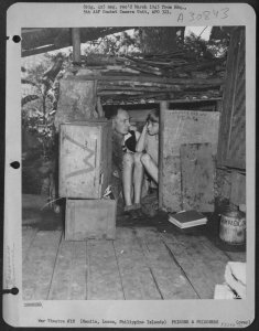 Archibald and Nicholas Mathews taking shelter at STIC during February 1945 Japanese shelling