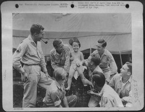 3-year-old Bobby Tangen with U.S. Air Force personnel after liberation from Old Bilibid Prison, 1945