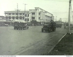 MANILA, THE PHILIPPINES, 1945. FAR EASTERN UNIVERSITY AND QUEZON BOULEVARD, SHOWING AMERICAN TRUCKS IN THE STREET. (DONOR: B. COOPER).