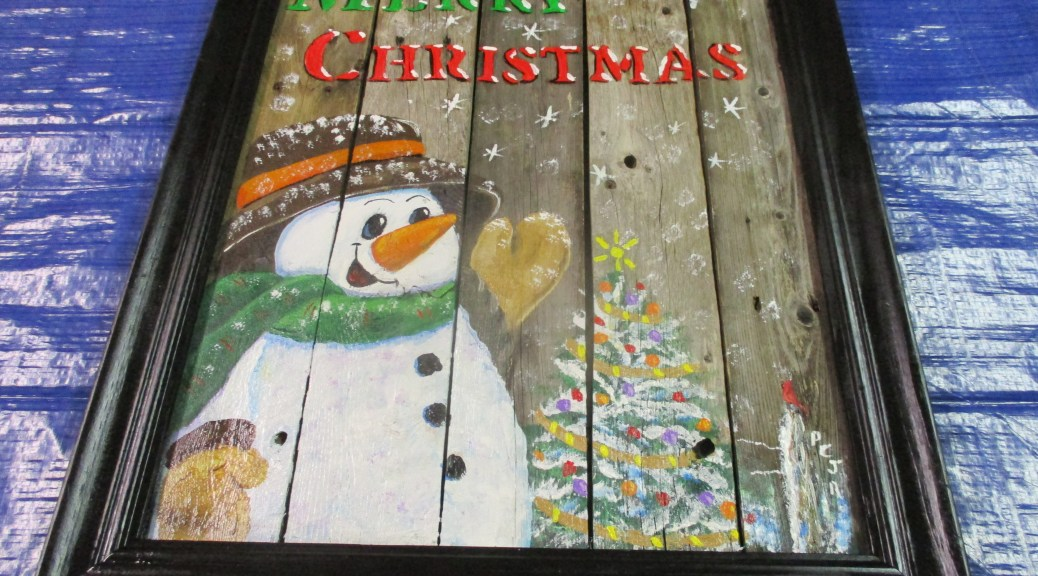 Christmas snowman on framed picket