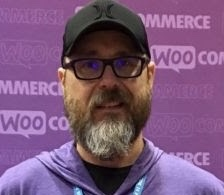 Phillip Cornwell working at the WooCommerce booth during WordCamp US 2019 in St. Louis, MO.