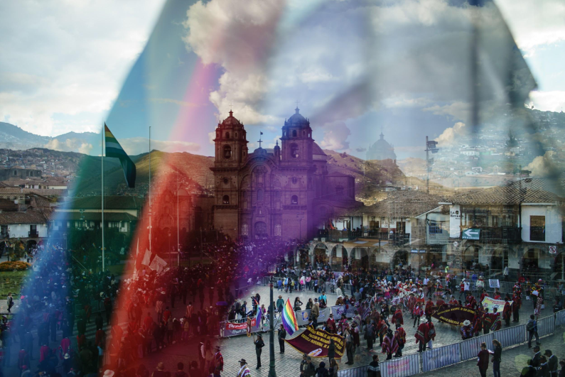 A church is reflected onto the flag of Cuzco — the former capital of the Inca Empire.