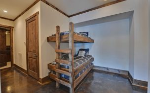 Extra space to sleep 3 more with these built in bunks and trundle bed.
