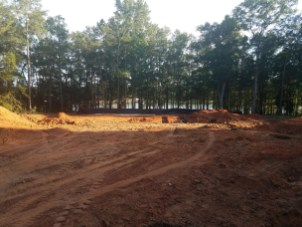 The lot showing the lake view after being cleared.
