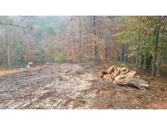 The build site with a pile of rock waiting to be relocated.