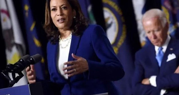 Kamala Harris speaking on front of Joe Biden