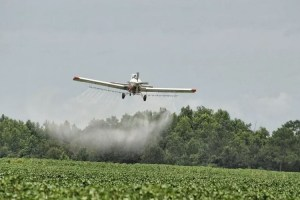 Crop duster spraying pesticides