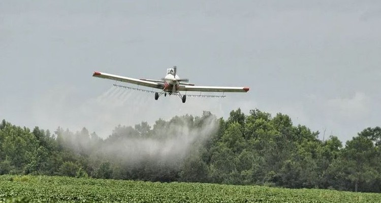Crop duster spraying pesticides