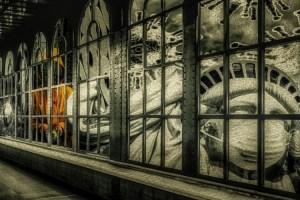 Window with Masked Statue of Liberty and Coronavirus