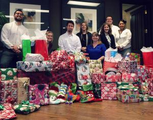 Attorneys at Phillips Murrah wrapped gifts for Oklahoma Family Network.