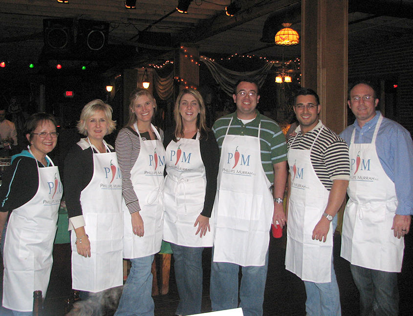 Phillips Murrah Attorneys prepare to compete in the Chili Cookoff.