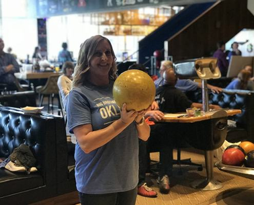 Sherree Williams waits for her turn to bowl at Bowling Night on May 10 at Dust Bowl Lanes