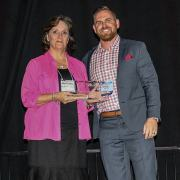 A. Michelle Campney, Phillips Murrah Construction Law Attorney, accepts ASA-OK's Service Provider of the Year award on behalf of the Firm.