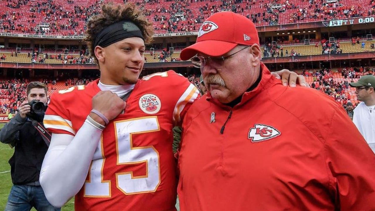 Patrick Mahomes with an arm around Andy Reid