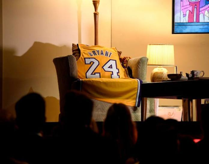 Kobe Bryant #24 Lakers jersey draped over a chair. showing his name & number