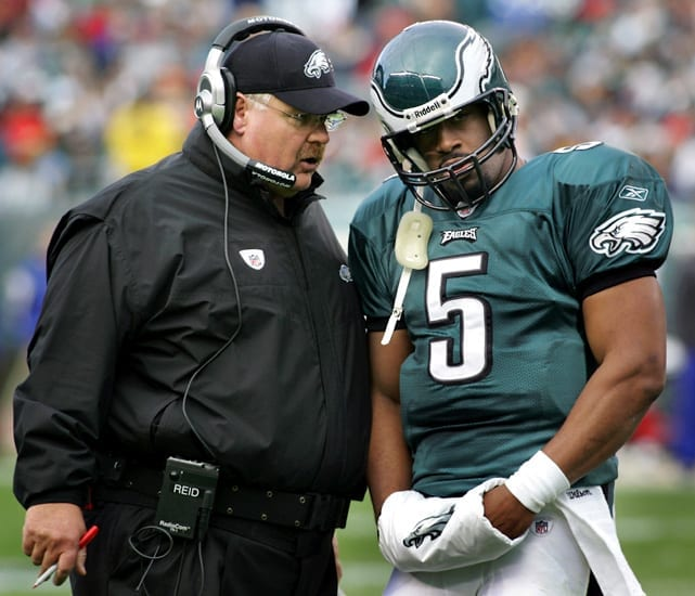 Andy Reid giving Eagles quarterback Donovan McNabb advice on the field