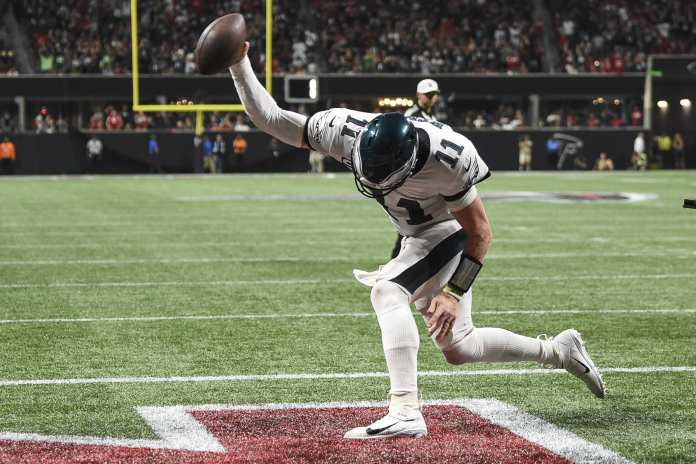 Carson Wentz spikes the ballas he adds to his career stats