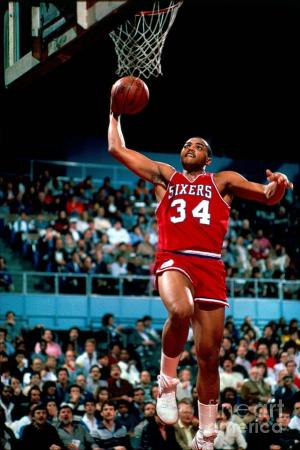 Charles Barkley goes to the rim as a member of the 76ers