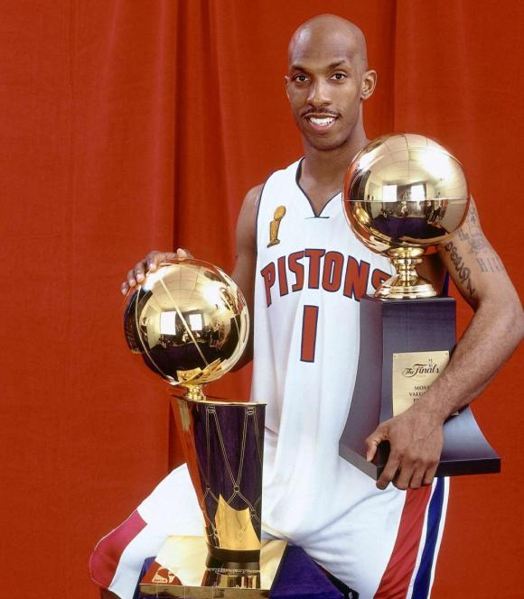 Chauncey Billups with the 2004 Larry o'Brien trophy and Finals MVP trophy. Posing in 2004.