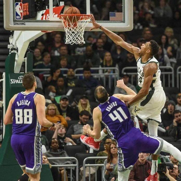 Giannis Antekoumnpo dunking 2020 NBA champion asterisk