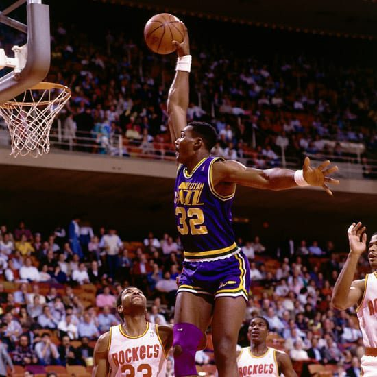 Karl Malone showing why he was called the mailman in the vintage NBA, as he delivers a thunderous dunk