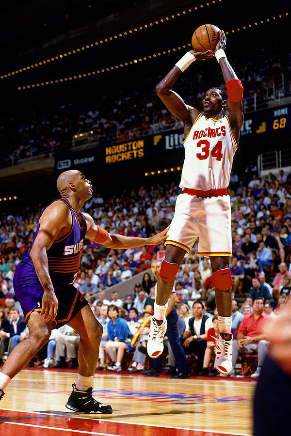 Hakeem Olajuwon shooting over Charles Barkley in the vintage NBA of the 1990's. the old NBA vs the new NBA