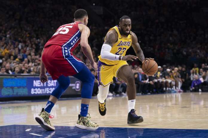 LeBron James tries to penetrate Ben Simmons' defense.
