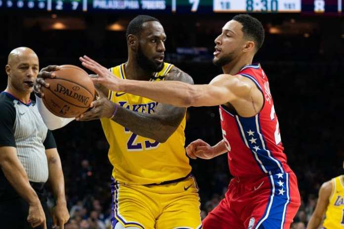 Ben Simmons plays tight defense on LeBron James
