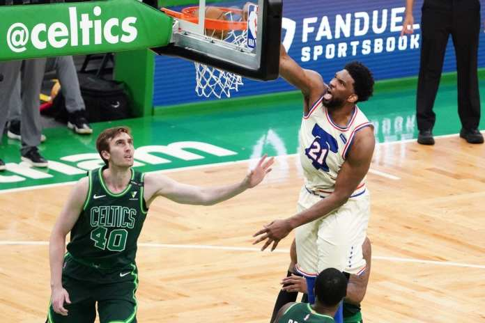 Joel Embiid dunks with authority in the 2020 Bubble in Orlando