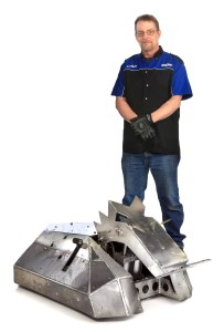 Photo of maker, Jerry Clarkin standing with his BattleBot, SubZero.