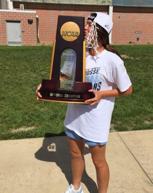 UNC's Marie McCool (Moorestown) kisses the national championship trophy