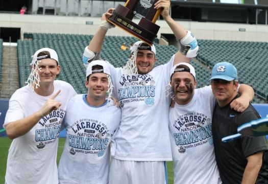 Philly guys (from left) Jake Peden,Charles Kelly, Austin Pifani, Coin Reder and assistant coach davvid Metzbower celebrate the NCAA championship