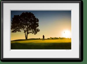 framed print of golfer on green