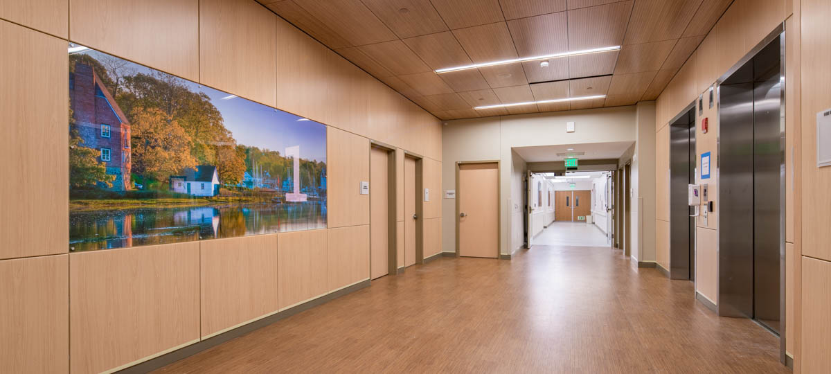 elevator lobby with large harbor mural