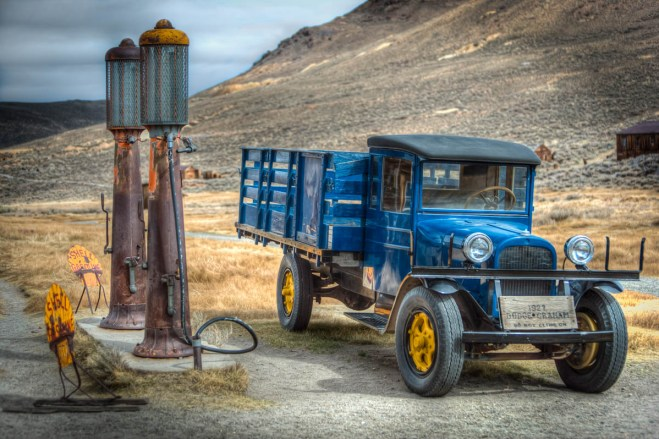 blue 1927 dodge truck at old gas pumps