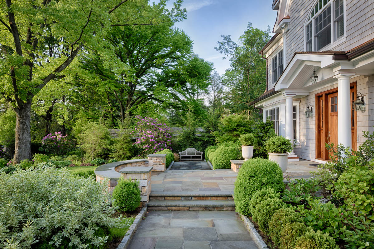 walkway to front of house with lush landscaping