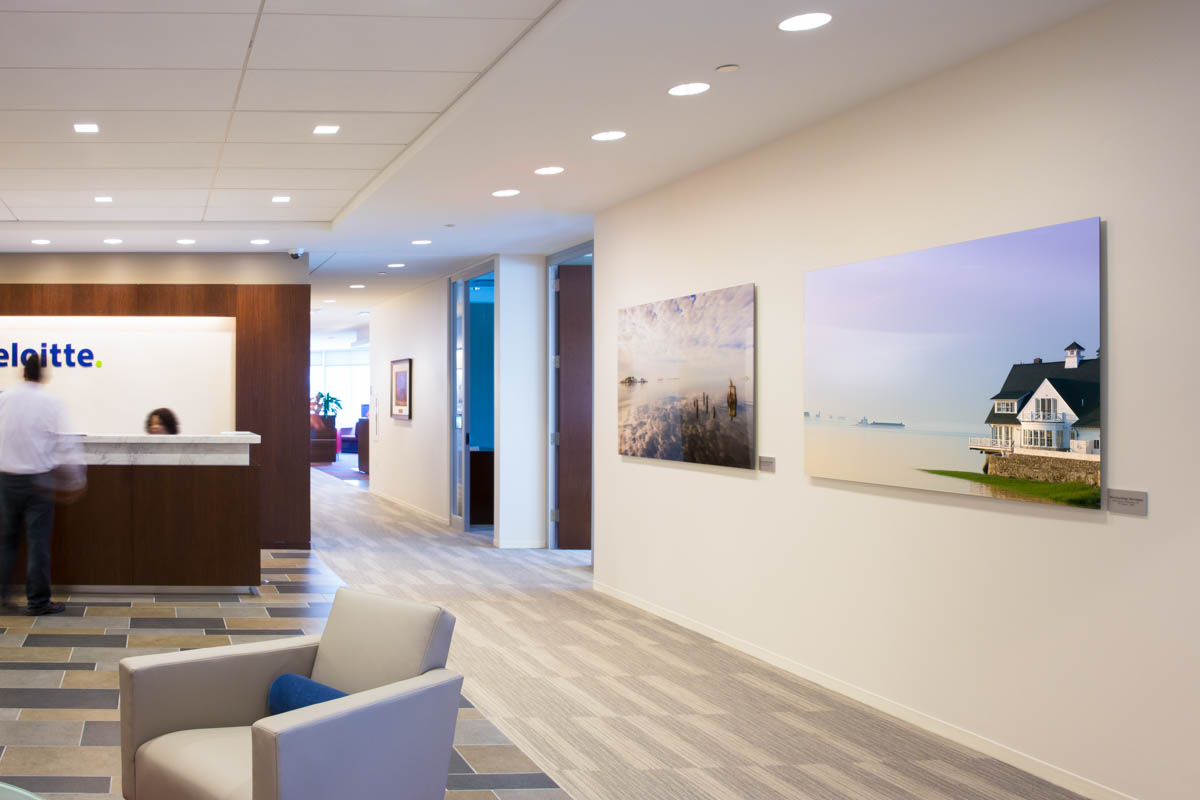 office reception area with two large acrylic face-mounted prints