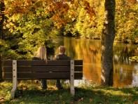 couple-man-woman-park-bench-pond-autumn-nature-768x1024