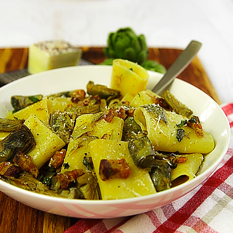 pasta paccheri with baby artichokes and pork belly