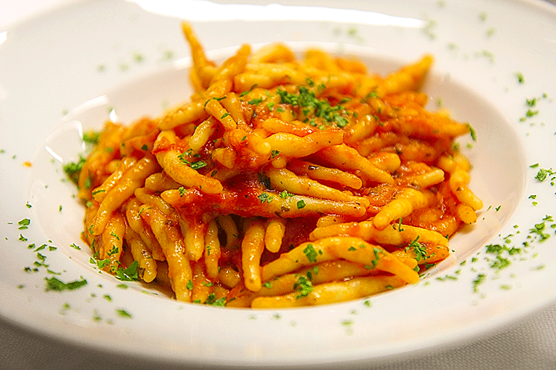 Trofie with spicy tomato sauce - where to eat in Florence, Tuscany, Italy