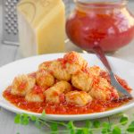 "GNOCCHI: ORIGIN AND EVOLUTION Gnocchi is maybe the most ancient Italian food. Mixing flour with water and other poor ingredients was the simpler way to eat for who couldn't afford the proteins. In the I Century BC, Marco Gavius Apicius write in his book ""The Re Coquinaria"" the first official recipe for gnocchi: a mixture of semolina flour combined with milk or water, then fried, and finally seasoned with honey and black pepper. This recipe is no so far from the contemporary version of Gnocchi Alla Romana. The term Gnocchi originates from the Langobardic word Knohha; that's means knot. In Lombardy, during the reign of Sforza family, it was common to serve the Zanzarelli, a medieval version of gnocchi made with bread, milk, minced almonds and Cacio Lodigiano cheese. In the XVII Century, almonds were replaced by flour and water by eggs, and gnocchi were called Malfatti. But, the ingredient which brings the ancient versions of gnocchi to the delicious dish worldwide famous, came from the other side of the ocean: the potatoes! A NEW VEGETABLE: POTATO Despite the early importation of Potatoes from the new continent, their use into the European cuisine starts from the XVIII Century. During the XVI and XVII centuries, in most parts of Europe the potatoes were considered a vegetable of the devil and poisonous and used to feed animals and war prisoners. The first Italian regions have begun to culture potatoes are Tuscany and Veneto, followed by Emilia-Romagna. Overcome the first suspicions, potatoes have become world-famous, and consumed in vast quantity, thanks to their low price and nutritious properties! Potatoes have revolutionized the Italian gnocchi, and they have partially replaced the amount of flour! Currently, the potato gnocchi are the most popular gnocchi in and outside Italy. Potatoes gnocchi are soften then others, and more digestible, and so tasty! TWO LEGENDS FOR A LEGENDARY RECIPE! Among several legends concerning potato gnocchi, two of them are particularly interesting. The first tale narrates of a big famine in Verona on 1531. The Venetian city was on the verge of a revolt, especially in the district of San Zeno, populated by poor people. To avoid the risk of a war class, Tommaso da Vico, a noble physician who lived in San Zeno, offered to the needy people an enormous quantity of supply, including flour, butter, wine, and cheese. Tommaso da Vico died the same year, but he left written in his will, that the people of San Zeno should receive supplies every last Friday of Lens. When the potatoes started to be popular, were included in the supplies given to the people. To remember the generosity of the Noble Venetian, potato gnocchi has become the traditional recipe of Carnival in Verona; a ritual still lives at this time! The second tale has an unusual protagonist, Alessandro Volta pioneer of electricity and power. Few people Know that Volta was a food enthusiast. On a visit to the French Court, probably at the end of XVIII Century, Volta met Antoine Parmentier, a French pharmacist. During the seven years war, Parmentier was imprisoned in Germany and fed with potatoes. This should have been a humiliation against the prisoners because potatoes were the food for animals. But, Parmentier found potatoes delicious, and when he come back in France started to experiment new recipes with potatoes! Alessandro Volta was so impressed by the Parmentier's potatoes recipes he tried to repeat them. The legend has it that one of the experiment was mixing potatoes with flour and eggs, creating the first version of potato gnocchi! MOST FAMOUS GNOCCHI RECIPES The most famous seasoning for potato gnocchi is a simple, fresh tomato sauce. Butter and sage, are mushrooms sauce are another popular way to seasoning them. But, thanks to the versatile taste of potato gnocchi, your fantasy is the only limit to toss and serve gnocchi! Italian regional cuisines have created plenty of particular gnocchi recipes. In Friuli, it is possible to find the biggest Italian potato gnocchi, stuffed with a whole plum and tossed with melted butter and sugar. Another recipe worldwide famous is Gnocchi Alla Sorrentina, baked dumplings seasoned with fresh tomato sauce, mozzarella, and sweet basil leaves, delicious! Besides potatoes, a recipe close to the medieval gnocchi recipes is Canederli, dumplings made with bread, milk, flour and cured meat, served with broth and garnished with chives. Another classic recipe is Gnocchi Alla Romana, made with semolina flour, Pecorino Romano, and butter, a must to try visiting Rome! In Mantova and Parma is typical prepare gnocchi with pumpkin and sage, tossed with butter and Parmigiano Reggiano. Finally, one of the most loved by kids: Chicche Verdi di Ricotta, little dumplings made with spinach and ricotta, seasoned with gorgonzola sauce! POTATO GNOCCHI TIPS • The best potatoes to make gnocchi are Russet potatoes, a bit old. • Yolks into the dough are suggested, but not mandatory. Gnocchi without yolks are more tender but tough to make. • The only way to preserve gnocchi more than a couple of hours is freezing them. Just place gnocchi into a tray lined with parchment paper and a sprinkle of flour. Leave space between gnocchi and freeze until completely frozen, then store in a plastic bag."