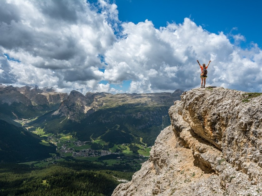 Showing someone at the top of the mountain to give an example of success