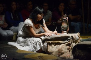 Estrella, a character in Fish Hair Woman, writes stories for her English class. Fish Hair Woman, authored by Merlinda Bobbis, was staged as musicale by De La Salle University's Harlequinn Theater Guild. (Photo by Beryl Lao)