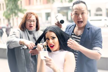 Runway Madness: It's a team effort, mother Elma Gillio and Managing Director of Miss Latina Australia 2015 , Gary Lee prepping Eva for her photo shoot. (Photo by Fourbysix Photography)