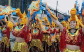 """Young students from public schools in Makati City perform street dancing in colorful costumes during the """"Caracol Festival 2017"""" on Sunday (Feb. 26, 2017). (PNA photo by Oliver Marquez)"""
