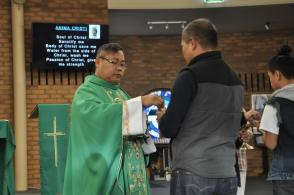 Fr Asis during the Holy Communion