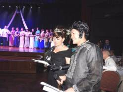 The emcees Michelle Baltazar as Audrey Hepburn and Marcus Rivera as Elvis, at the Tribute to Mothers and Fathers Night 2017.
